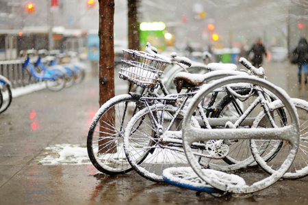 blustery: Snow covered bicycles after snowfall in New York, USA