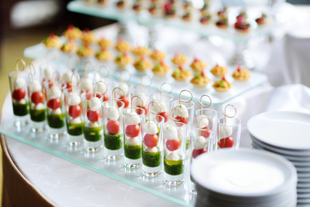 Plates with assorted finger food snacks on an event party or dinner 스톡 콘텐츠