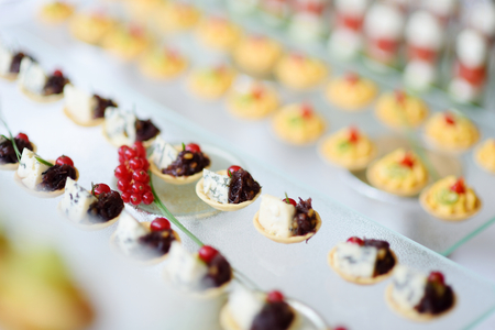 catering: Plates with assorted finger food snacks on an event party or dinner Stock Photo
