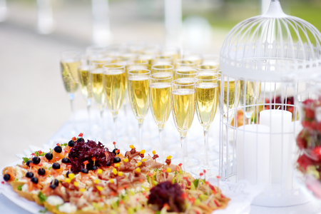 drinks on bar: Lots of wine glasses during some festive event Stock Photo