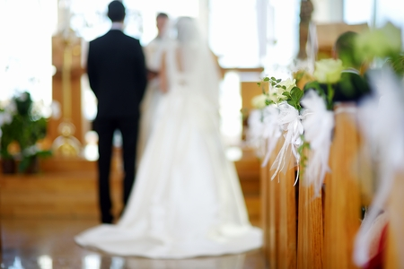 christian marriage: Beautiful flower wedding decoration in a church during catholic wedding ceremony Stock Photo