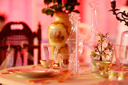 dinner menu: Table set for an event party or wedding reception in red light