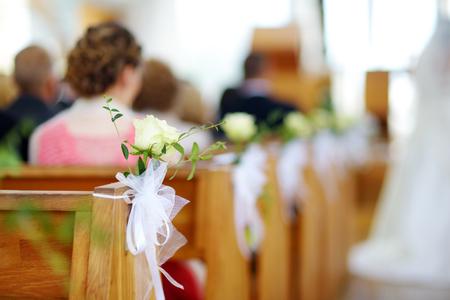 church flower: Beautiful flower wedding decoration in a church during catholic wedding ceremony Stock Photo