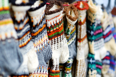 sunday market: Colorful warm knitted socks sold on Easter market in Vilnius, Lithuania