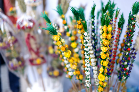 sunday market: Traditional Lithuanian Easter palm known as verbos sold on spring market in Vilnius, Lithuania