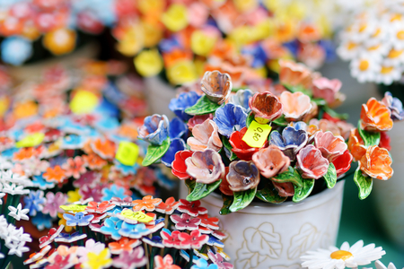 holy jug: Colorful ceramic flowers sold on Easter market in Vilnius, Lithuania Stock Photo