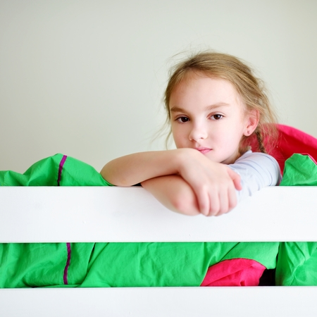 bunk bed: Adorable little girl having fun in twin bunk bed on sunny sunday morning