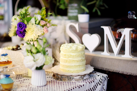 sweet table: Decorated colorful cupcakes and desserts on a sweet table on some festive event