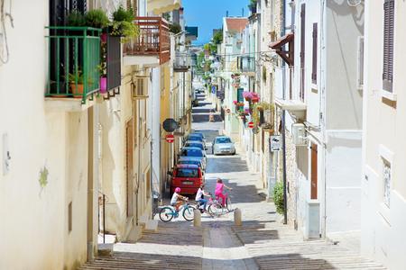 CONVERSANO, ITALY - MAY 30, 2015: Typical medieval narrow street in beautiful town of Conversano, Italy Editorial