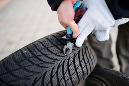 Pulling a nail out of tire