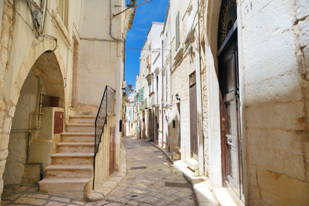 Typical medieval narrow street in beautiful town of Conversano, Italy Stock Photo