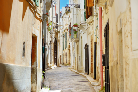 conversano: Typical medieval narrow street in beautiful town of Conversano, Italy Stock Photo