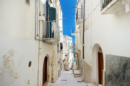 foggia: Typical medieval narrow street in beautiful town of Vieste, Italy