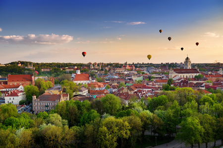 Beautiful summer panorama of Vilnius old town with colorful hot air balloons in the sky, taken from the Gediminas hill