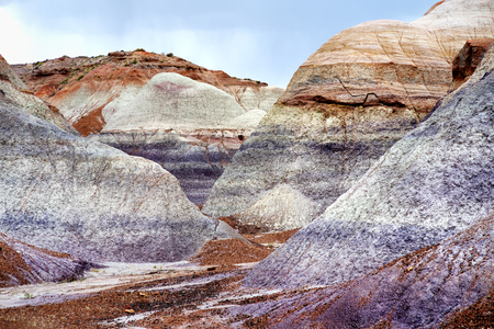 soil erosion: Striped purple sandstone formations of Blue Mesa badlands in Petrified Forest National Park, Arizona, USA