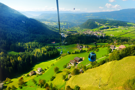 Cableway to Seiser Alm, the largest high altitude Alpine meadow in Europe. South Tyrol province of Italy, Dolomites