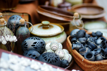 holy jug: Ceramic dishes, tableware and jugs sold on Easter market in Vilnius. Lithuanian capitals annual traditional crafts fair is held every March on Old Town streets.
