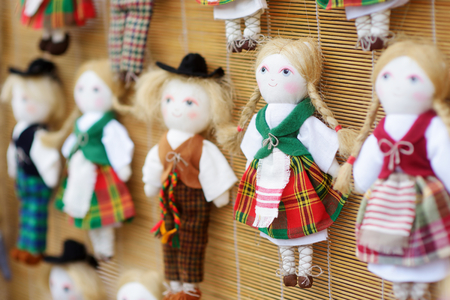 Cute handmade ragdoll dolls in Lithuanian national costumes sold on Easter market in Vilnius. Lithuanian capitals annual traditional crafts fair is held every March on Old Town streets.