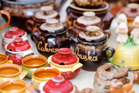 religion ritual: Ceramic dishes, tableware and jugs sold on Easter market in Vilnius. Jars for SUGAR and SALT. Lithuanian capitals annual traditional crafts fair is held every March on Old Town streets.