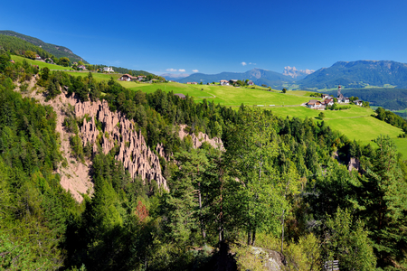 monument valley view: Earth pyramids of South Tyrol, RenonRitten region, Italy. Natural phenomenon that comes about in particular terrain, usually after a landslide or an unhinging of the earth.