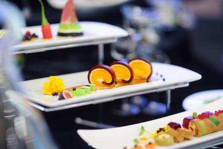 Molecular modern cuisine. Various fancy dishes on white plates in trendy restaurant.