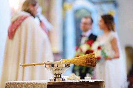 rite: Priests wedding accessories during catholic wedding ceremony in a church Stock Photo
