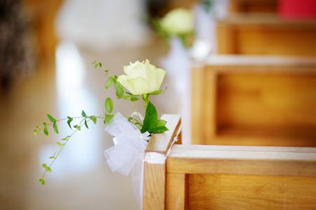 Beautiful flower wedding decoration in a church during catholic wedding ceremony Stock Photo