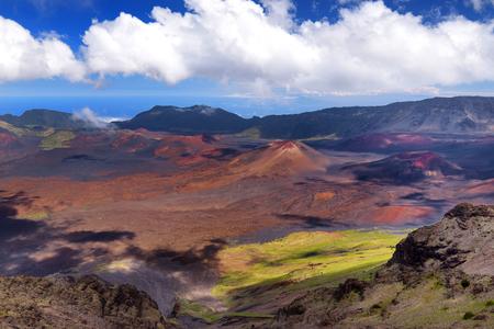 Stunning landscape of Haleakala volcano crater taken at Kalahaku overlook at Haleakala summit. Birds-eye view of the crater floor and the trails snaking around the cinder cones below. Maui, Hawaii