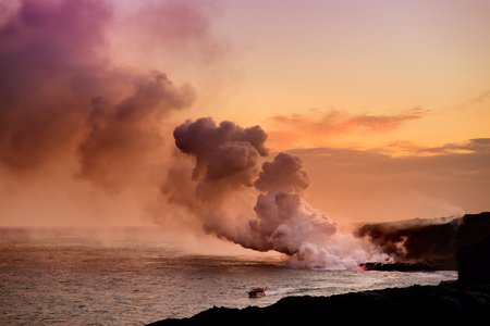 Lava pouring into the ocean creating a huge poisonous plume of smoke at Hawaiis Kilauea Volcano, Volcanoes National Park, Big Island of Hawaii Stock Photo
