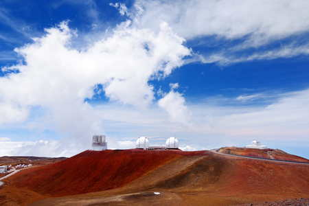 Observatories on top of Mauna Kea mountain peak. Astronomical research facilities and large telescope observatories located at the summit of Mauna Kea on the Big Island of Hawaii, United States