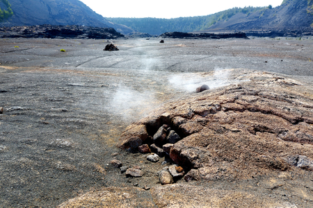 Steaming vents on the Kilauea Iki volcano crater surface with crumbling lava rocks in Volcanoes National Park in Big Island of Hawaii, USA