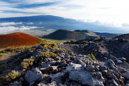 Breathtaking view of Mauna Loa volcano on the Big Island of Hawaii. The largest subaerial volcano in both mass and volume, Mauna Loa has been considered the largest volcano on Earth. Stock Photo