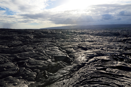 Endless lava fields of the Big Isalnd of Hawaii. Smooth, undulating surface of frozen pahoehoe lava. Hawaii, USA. Stok Fotoğraf