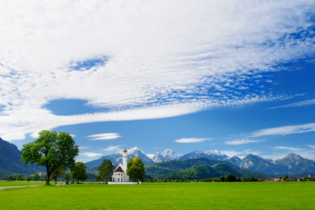 Beautiful white St. Coloman pilgrimage church, located near famous Neuschwanstein castle, Bavaria, Germany.