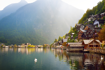 Scenic view of Hallstatt lakeside town in the Austrian Alps in beautiful evening light on beautiful day in autumn. Hallstatt, situated on Hallstatter See, a market town in the district of Gmunden. Stock Photo