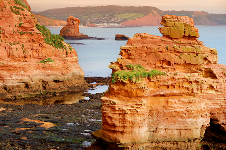 Impressive red sandstones of the Ladram bay on the Jurassic coast, a World Heritage Site on the English Channel coast of southern England, Devon, UK.