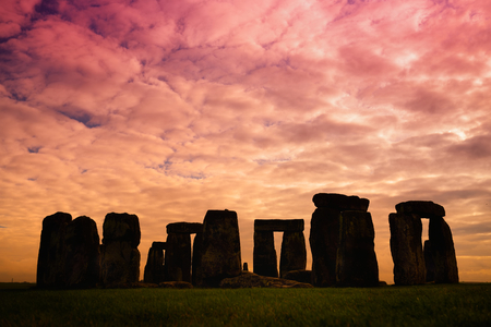 Stonehenge, one of the wonders of the world and the best-known prehistoric monument in Europe, located in Wiltshire, England, UK. Stone silhouettes at sunset.