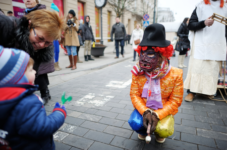 VILNIUS, LITHUANIA - FEBRUARY 25, 2017: Hundreds of people celebrating Uzgavenes, a Lithuanian annual folk festival taking place before Easter. Participants wearing traditional masks and costumes. Editorial