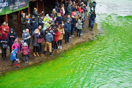 VILNIUS, LITHUANIA - MARCH 18, 2017: Hundreds of people enjoying festivities and celebrating St. Patrick's day in Vilnius. Vilnele river was dyed green to mark the patron saint of Ireland's day. Editorial
