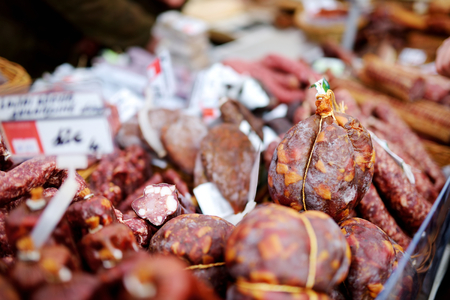 Selection of assorted home made sausages on a farmers market in Vilnius, Lithuania. Traditional spring fair in capital of Lithuania.