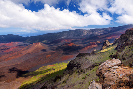 Stunning landscape of Haleakala volcano crater taken at Kalahaku overlook at Haleakala summit. Birds-eye view of the crater floor and the trails snaking around the cinder cones below. Maui, Hawaii