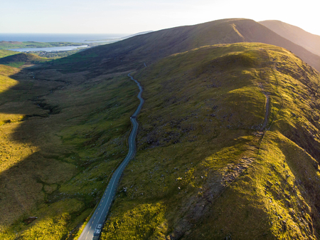 Aerial view of Conor Pass, one of the highest Irish mountain passes served by an asphalted road, located on the south-western end of the Dingle Peninsula, County Kerry, Ireland