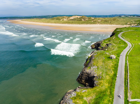 Spectacular Tullan Strand, one of Donegal's renowned surf beaches, framed by a scenic back drop provided by the Sligo-Leitrim Mountains. Wide flat sandy beach in County Donegal, Ireland. Stock Photo