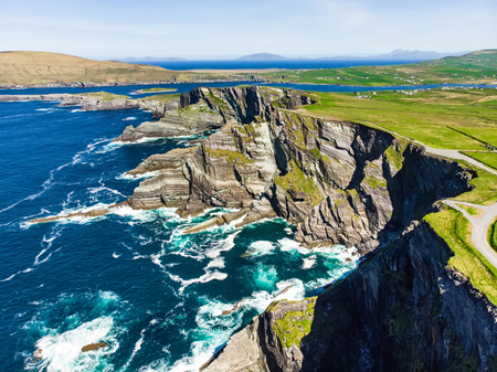 Amazing wave lashed Kerry Cliffs, widely accepted as the most spectacular cliffs in County Kerry, Ireland. Tourist attractions on famous Ring of Kerry route.