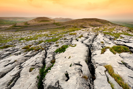Spectacular landscape of the Burren region of County Clare, Ireland. Exposed karst limestone bedrock at the Burren National Park. Rough Irish nature.