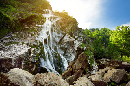 Majestic water cascade of Powerscourt Waterfall, the highest waterfall in Ireland. Famous tourist atractions in co. Wicklow, Ireland.