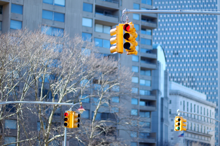 New York city traffic lights with skyscrapers on background, USA