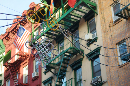 Hanging street decorations in Chinatown district of New York City, USA, one of oldest Chinatowns outside Asia.