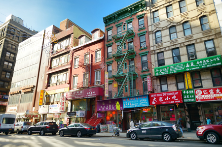 NEW YORK - MARCH 21, 2015: Street view of Chinatown district of New York City, one of oldest Chinatowns outside Asia.