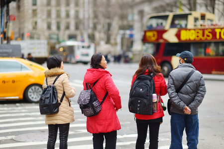 NEW YORK - MARCH 16, 2015: People crossing a street in downtown Manhattan. Tourists and newyorkers walking across a busy NYC crosswalk. Sajtókép